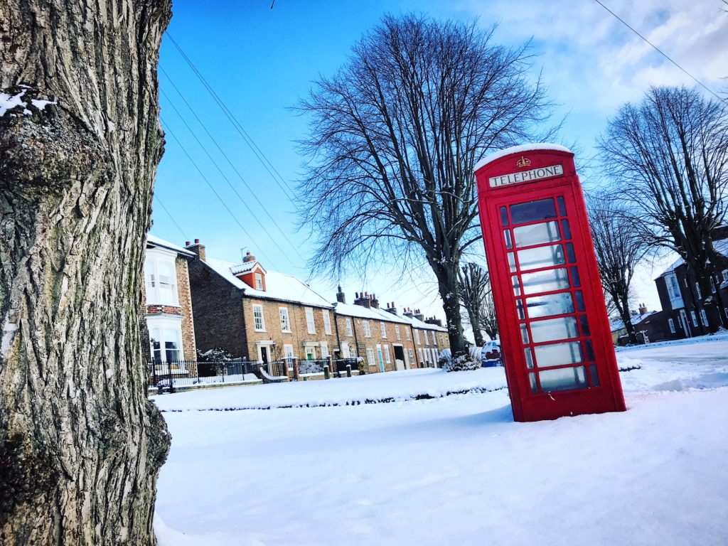 Red phone box in Uppleby in the snow