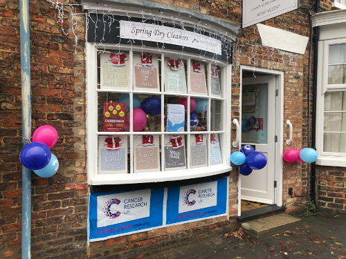 Spring Dry Cleaners window display for Christmas fundraising success